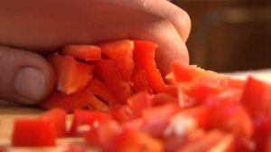 stock-footage-cutting-pepper-salad-in-the-kitchen-close-up